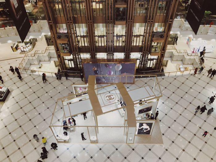 Chanel Looking Down Shopping Mall High Angle View Architecture Day Built Structure Indoors  Large Group Of People People