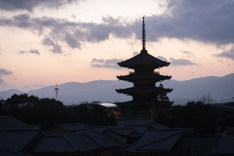 Low angle view of pagoda against sky during sunset