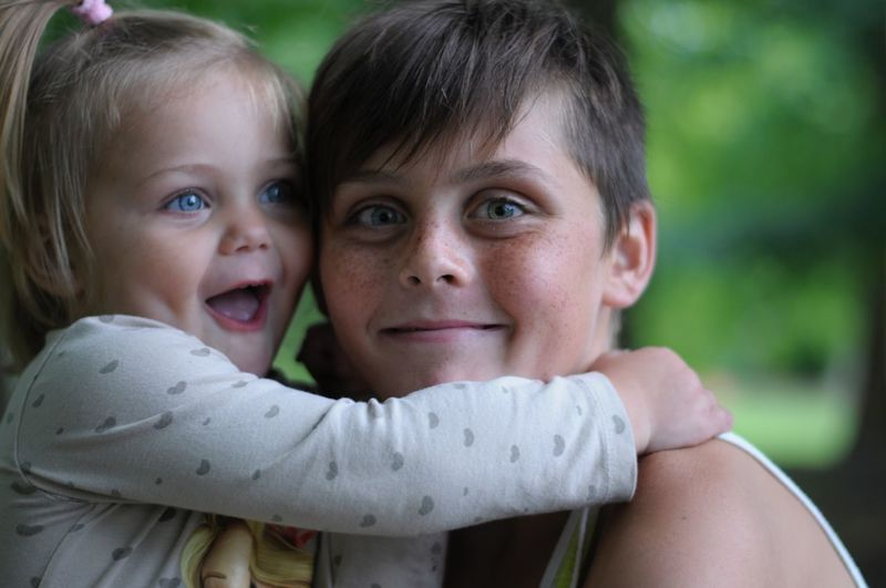 Portrait Of Brother With Cute Sister