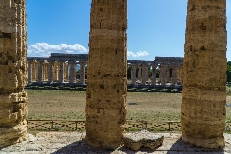 Paestum Roman ruins, Italy Temple Temple Of Ceres Roman Ruins Sky Architecture Nature History Day Built Structure The Past No People Land Outdoors Architectural Column Old Ancient Sunlight Old Ruin Water Ancient Civilization Travel Destinations Blue Cloud - Sky The Architect - 2018 EyeEm Awards