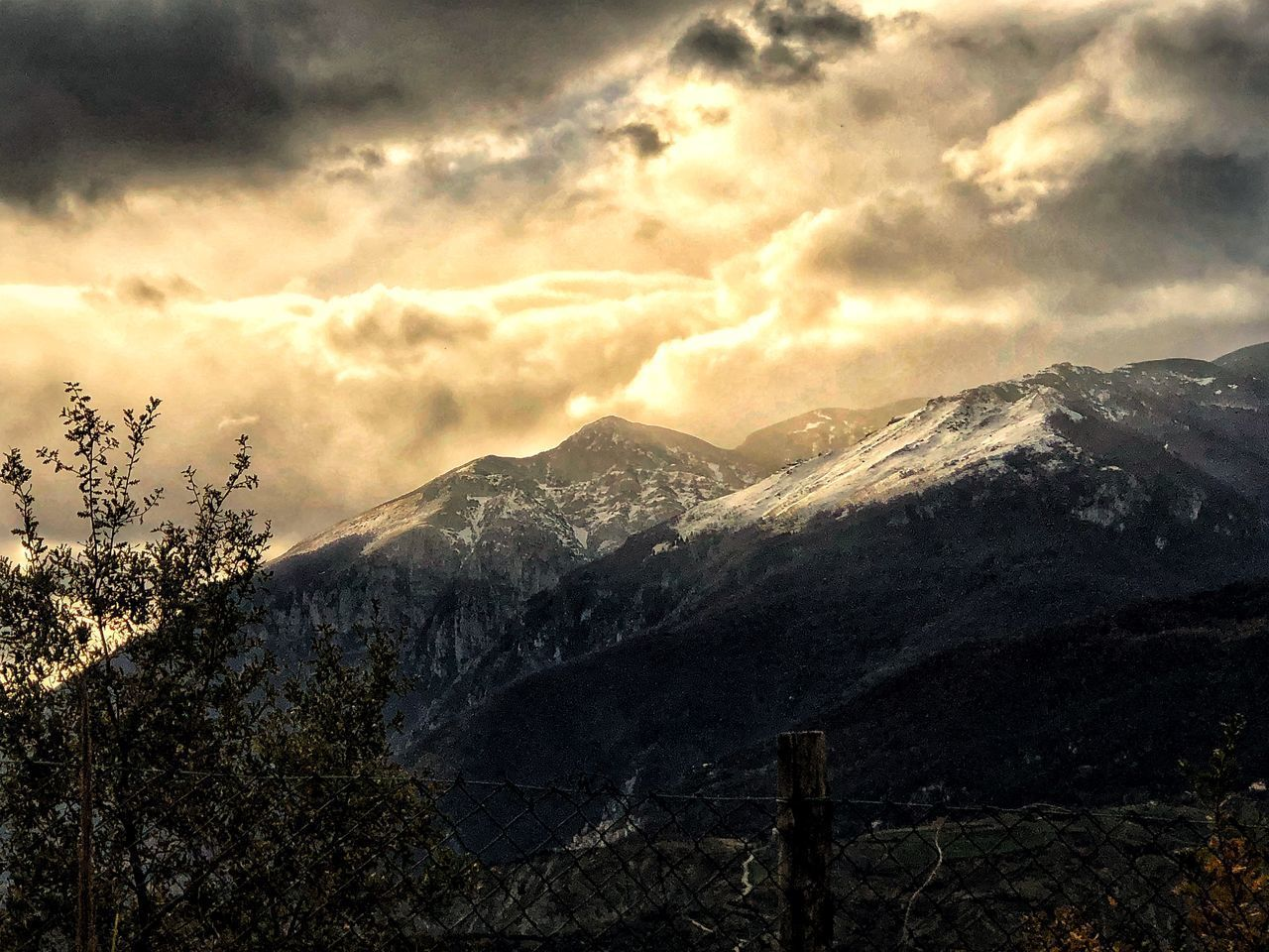mountain, sky, cloud - sky, beauty in nature, scenics - nature, environment, nature, mountain range, landscape, cold temperature, snow, tranquil scene, winter, no people, tranquility, outdoors, idyllic, non-urban scene, sunset, mountain peak, snowcapped mountain, range