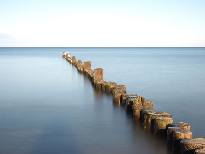 Water Sea Sky Horizon Scenics - Nature Horizon Over Water Beauty In Nature Wooden Post Clear Sky Day Nature Waterfront No People Outdoors