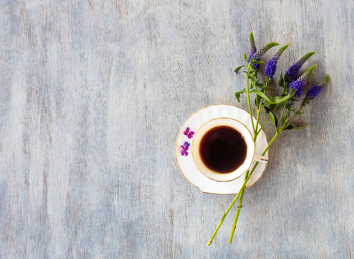 Cup Table Drink Plant Refreshment Mug Freshness Food And Drink Flower Flowering Plant Directly Above Coffee - Drink Coffee High Angle View Coffee Cup Nature Indoors  Still Life Tea Hot Drink No People Tea Cup Purple Crockery