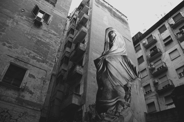 napoli, quartieri spagnoli Napoli Architecture Art And Craft Building Exterior Built Structure Creativity Day Human Representation Low Angle View Male Likeness Murales No People Outdoors Quartieri Spagnoli Sky Spirituality Statue Window