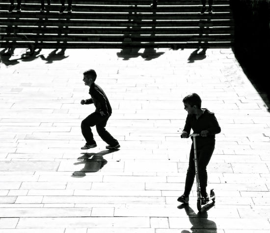 Artistic Vision Black And White Childhood Children City Contrast Day Emotions Life Lifestyles Love Outdoors People Playground Real People Shadow Silhouettes Silhouettes Of People Stairs Street Street Photography Urban