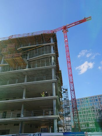 Berlin, Germany - February 3, 2018: Scaffolding and tower crane on construction site Berlin Construction Construction Frame Construction Site Construction Machinery Foundation Gentrification Growth High Scaffolding Tower Crane Tower Cranes Construction Industry Foundations Future High Building High Buildings Highness New Building