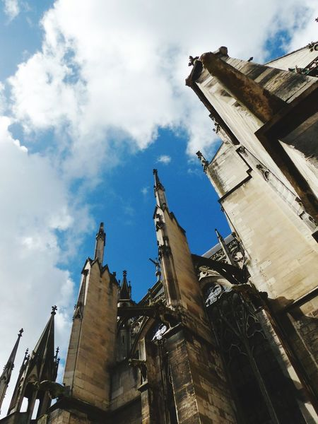 Architecture Travel Destinations History Tourism Cloud - Sky Low Angle View Sky Building Exterior Built Structure Statue Outdoors Sculpture No People Blue Day City Tree Gothic Architecture Sacral Architecture Church Cathedral Spirituality Architecture Religion Blue Sky
