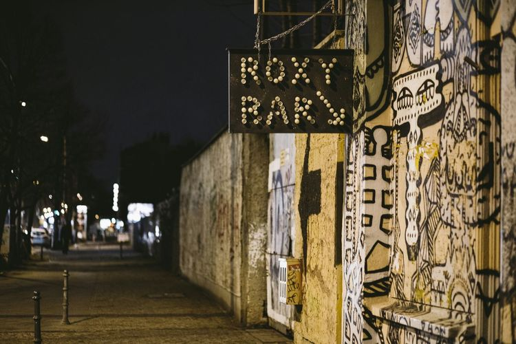 From my archive: 2013, the old Chausseestrasse east side with the temporary nightlife at Roxy Bar. Many fashion events were there. Chausseestrasse Berlin Berlin Mitte Berlin By Night Roxybar Streetphotography Street Night Lights Night Life Bars