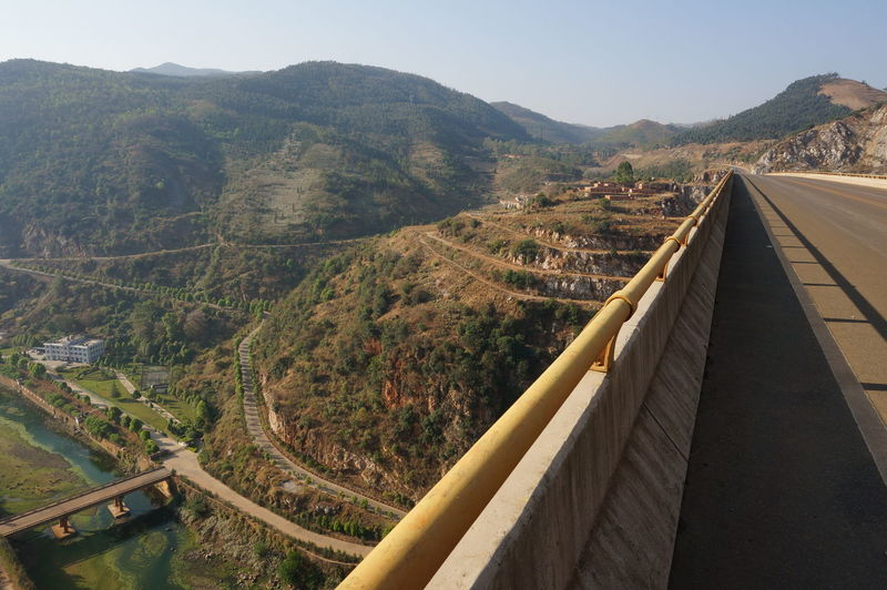 High Angle View Of Road Leading Towards Mountains