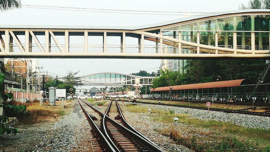 Train on railway bridge against sky