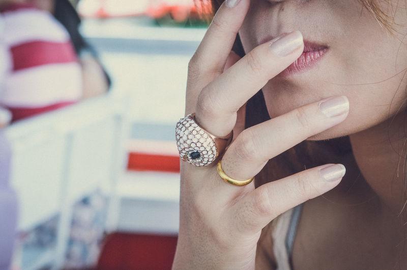 Close-up of woman touching lips