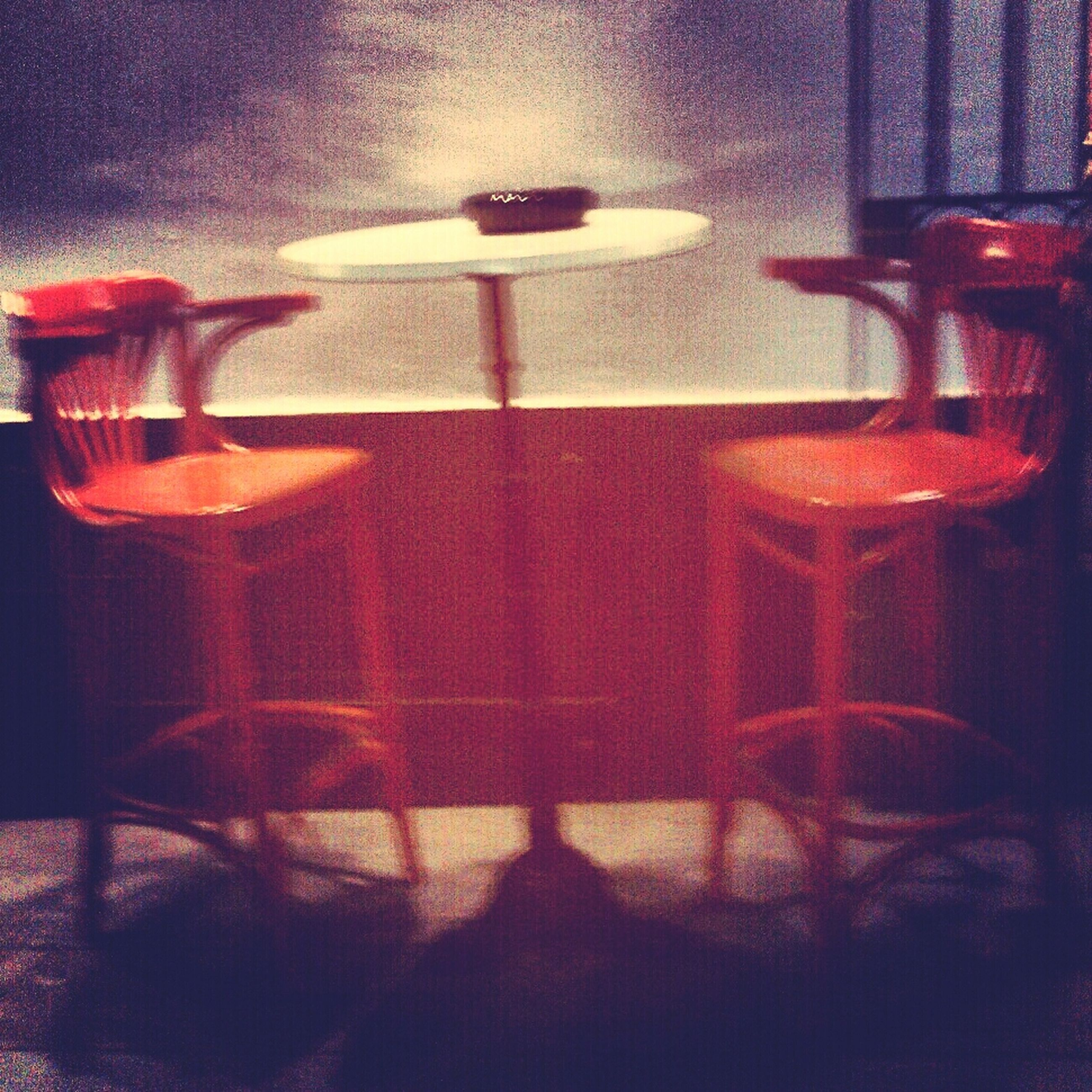 indoors, illuminated, home interior, lighting equipment, wall - building feature, red, absence, light - natural phenomenon, window, no people, empty, chair, reflection, domestic room, room, curtain, dark, night, electricity, electric lamp