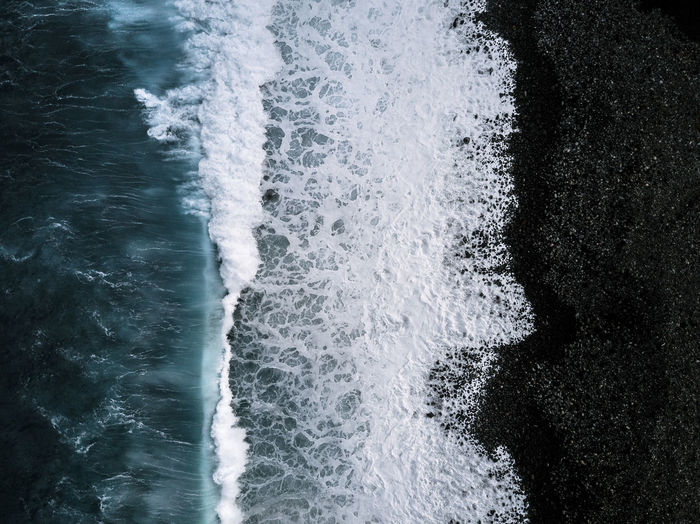 Abstract aerial of waves hitting a black sand beach on Madeira, Portugal DJI X Eyeem The Week on EyeEm Aerial Beauty In Nature Crash Day Force Motion Nature No People Outdoors Power In Nature Sea Water Waterfront Wave Shades Of Winter The Great Outdoors - 2018 EyeEm Awards