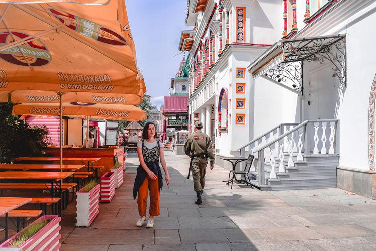 People walking on street amidst buildings in city