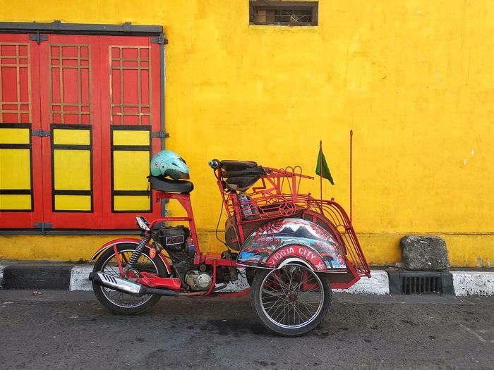 Bentor ( Becak Motor ) Transportation People Transportation Becak Bentor Becak Motor City Motorcycle Yellow Stationary Land Vehicle Bicycle Tire Architecture Building Exterior Built Structure Taxi Yellow Taxi Motor Scooter