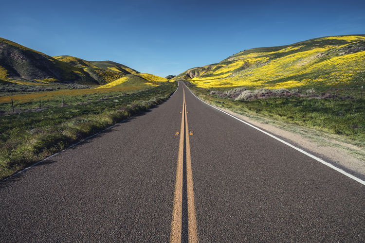 Keep moving forward. Beauty In Nature Clear Sky Day Grass Landscape Mountain Nature No People Outdoors Road Rural Scene Scenics Sky Transportation Winding Road