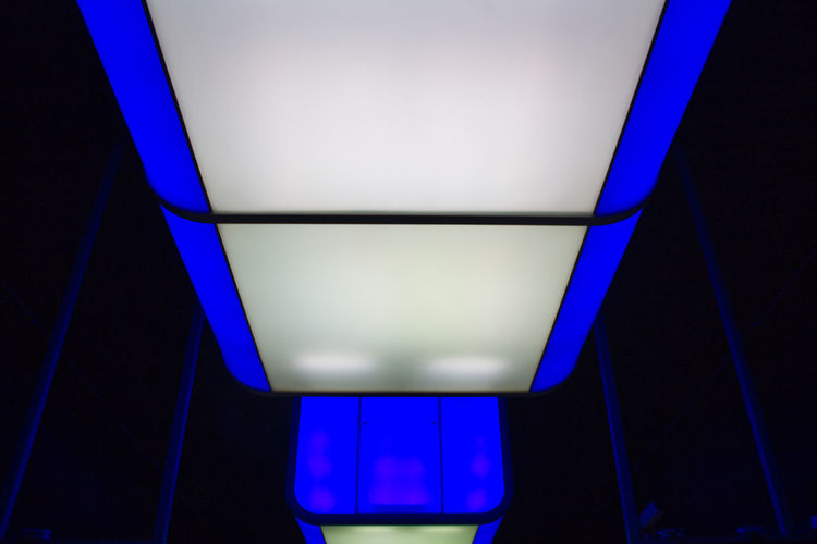 Blue Indoors  Illuminated Lighting Equipment No People Architecture Night Electric Light Low Angle View Light Glowing Technology Ceiling Flooring Built Structure Transportation Light - Natural Phenomenon Sign Dark Direction Nightlife Underground Underground Station
