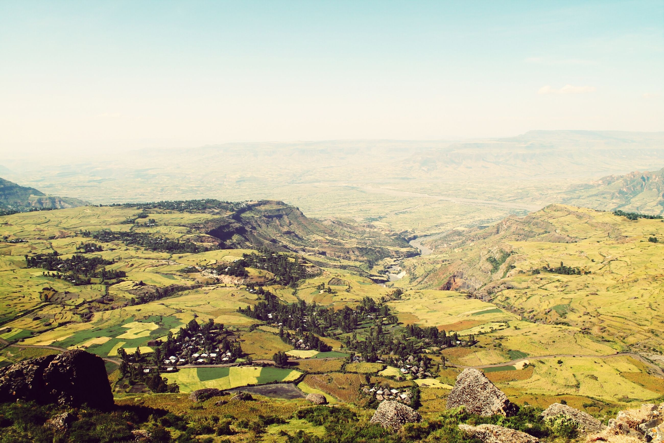 mountain, landscape, tranquil scene, scenics, tranquility, beauty in nature, nature, high angle view, mountain range, sky, idyllic, non-urban scene, tree, hill, green color, clear sky, remote, horizon over land, day, field
