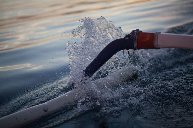 Cropped Image On Paddleboard In Lake