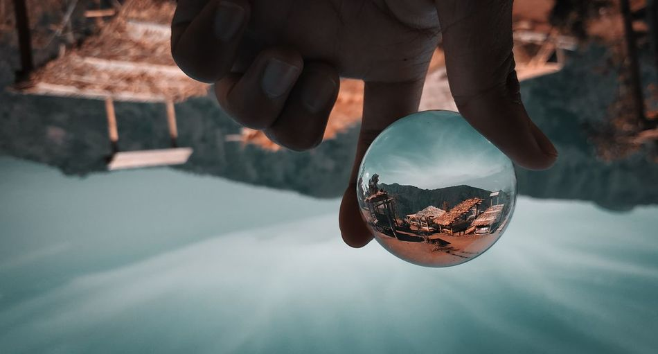 Upside down image of person holding crystal ball