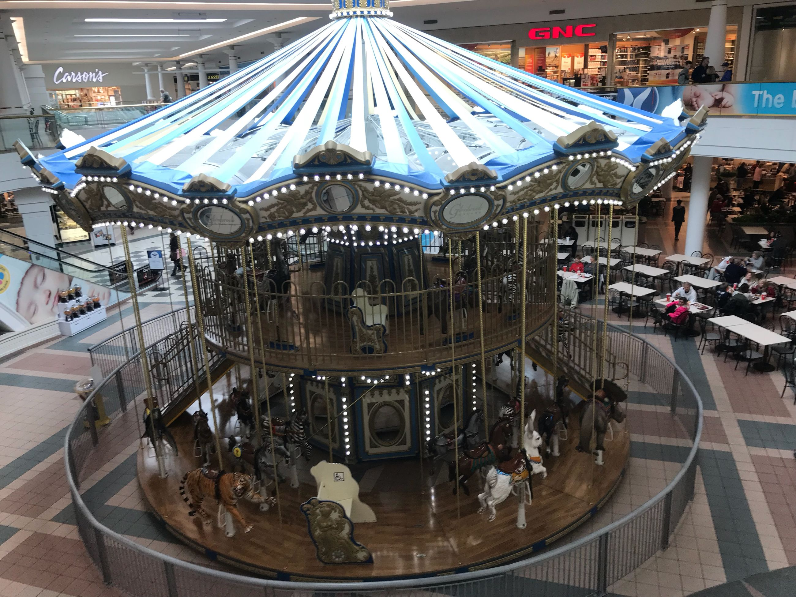 arts culture and entertainment, amusement park, amusement park ride, carousel, built structure, illuminated, large group of people, merry-go-round, architecture, day, indoors