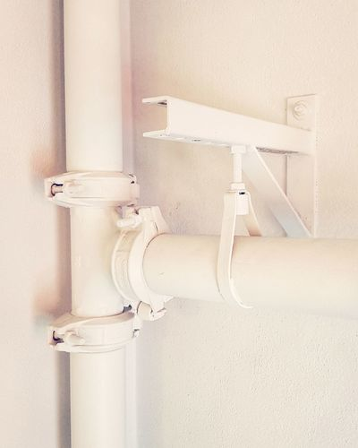 White contraption. White Interior Colorful Shadows Pipe - Tube White Color Close-up Architecture Water Pipe Pipeline Pipe Hinge