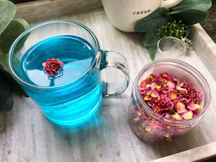 Floating Rose Edible Flowers Rosé Food And Drink Healthy Eating Food Drink Freshness Wellbeing Fruit Refreshment Berry Fruit Table High Angle View Glass Container Plant Indoors  Drinking Glass Smoothie Still Life No People Nature