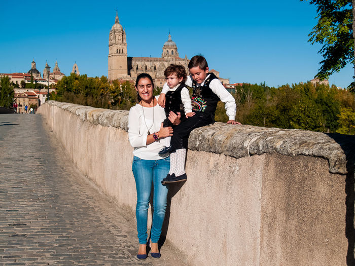 Family Child Childhood Children Real People Lifestyles Travel Salamanca Travel Destinations Tourism Tourist Destination Catedral De Salamanca Cathedral City Urban Traveler Enjoying Life Leisure Brother Traditional Clothing Spanish Culture SPAIN Love Smiling Architecture Built Structure Full Length Casual Clothing Looking At Camera Togetherness Building Exterior Young Adult Portrait Young Men Emotion Leisure Activity Day Sky Standing Women Young Women Outdoors Couple - Relationship