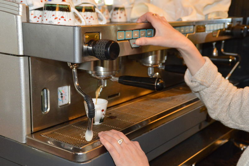 Cropped image of woman preparing coffee