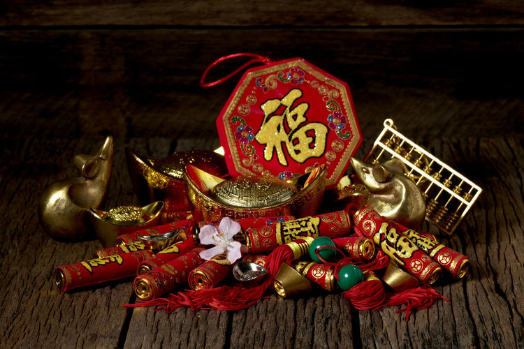 Chinese New Year Lunar New Year Good Luck Decoration Festive Wooden Table Luck Mascot Flat Lay Celebration Craft Firecrackers Ornament Gold China 2020 2019 Pig Minimal Sales Envelope Celebrations Flowers Lucky Tradition Symbol Red Fu Background Festival Spring Holiday Traditional Gold Culture Oriental Fortune Asian  ASIA Packet Plum Blossom Design Celebrate Greeting Prosperity Auspicious Money Happiness Firecracker Ingot Wood - Material Indoors  No People Still Life Group Of Objects Close-up Antique Art And Craft History High Angle View Event Christmas Text Christmas Ornament
