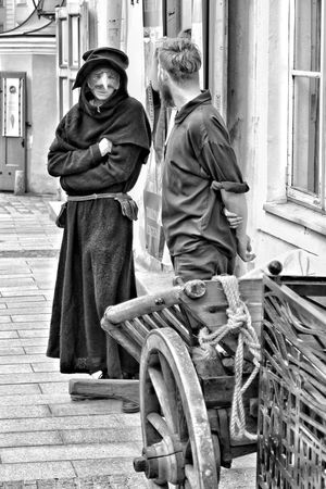 Architecture Two People Day Outdoors Men Standing City Tallinn Old Town Medieval Town Cobblestone Medieval Plague Doctor PlagueDoctorMask Peasant People Plague Bird Mask Blackandwhite Snapseed Freshness Windows Houses Travel Destinations Tallinn Rope