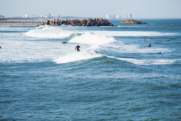 Spring surf in Ichinomiya Ichinomiya Surf Photography Japan Adventure Japan Photography Water Sea Sport Real People Aquatic Sport Leisure Activity Beauty In Nature Day Waterfront Lifestyles Motion Wave Surfing Outdoors People Scenics - Nature Men Nature