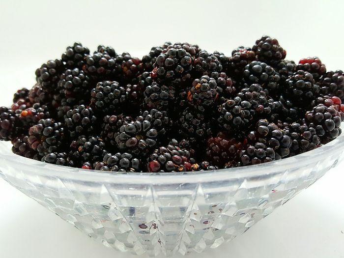 Blackberries in bowl on white background