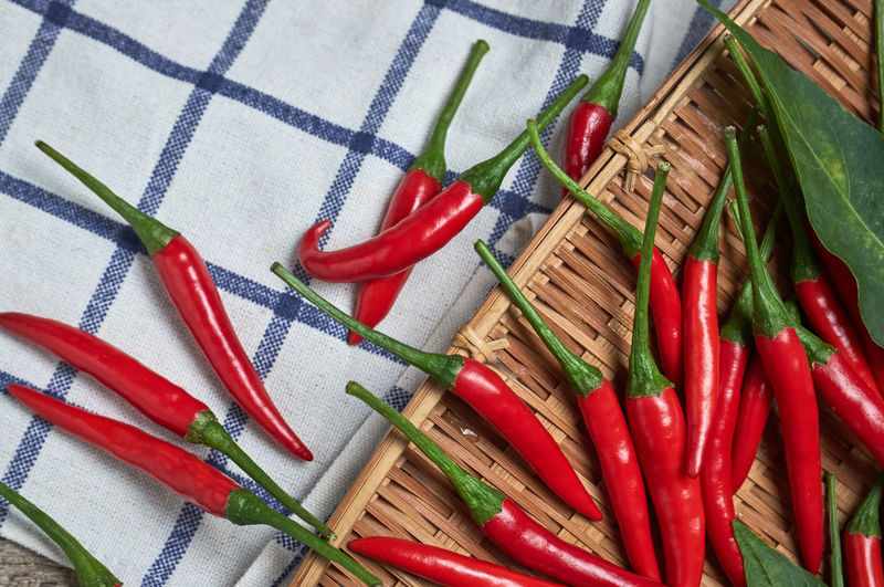 High angle view of multi colored chili peppers