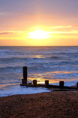 Sea Water Sunset Sky Horizon Horizon Over Water Scenics - Nature Beauty In Nature Beach Wave Orange Color Land No People Tranquility Nature Tranquil Scene Motion Cloud - Sky Idyllic Sun Outdoors Wooden Post
