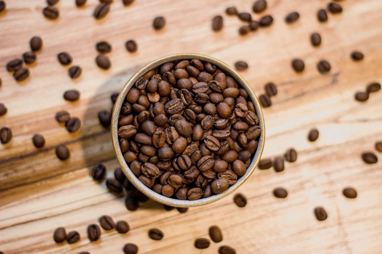 Food And Drink Roasted Coffee Bean Wood - Material Coffee Coffee - Drink Brown Food Freshness No People Indoors  Close-up Large Group Of Objects Still Life Seed High Angle View Roasted Table Directly Above Abundance Caffeine