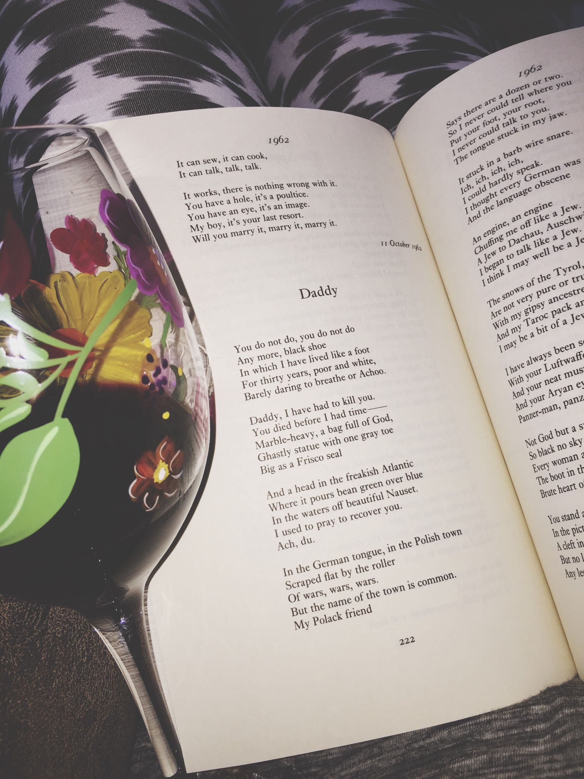 indoors, text, western script, communication, book, table, paper, still life, close-up, education, freshness, page, high angle view, open, finance, food and drink, no people, handwriting, message, part of