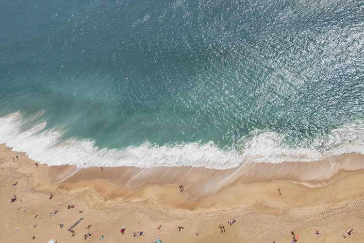 The beach of Nazaré seen from above - Portugal Nazaré  Portugal Water Sea Beach Sand Wave Beauty In Nature Scenics - Nature Nature Day Tranquil Scene Tranquility Outdoors People Power In Nature Motion Sport High Angle View Land From Above  View From Above Aquatic Sport