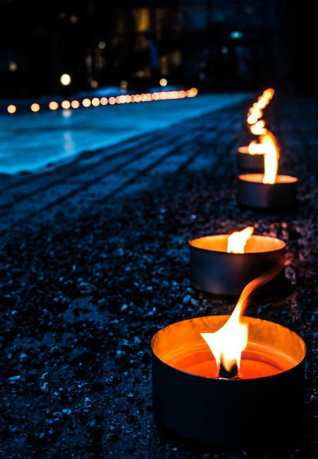 Burning Candle Close-up Diwali Diya - Oil Lamp Flame Focus On Foreground Glowing Heat - Temperature Illuminated Nature Night No People Oil Lamp Outdoors Retaining Wall Sky Water