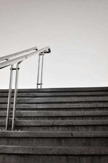 Spars composition of stairs going up. Architecture Built Structure Cement Clear Sky Day Direction Handrail Metal High Section Indastrial Low Angle View Metal Monochrome Moody No People Outdoors Simple Sky Sparse Stairs Stone Steps Suburb Up Urban