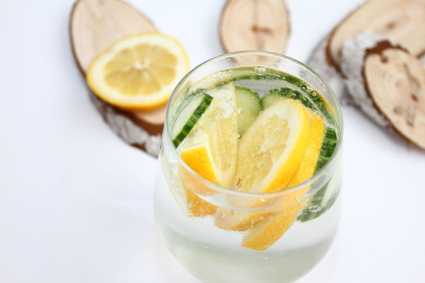 Detox flavored water with lemon and cucumber on white background with wood decoration. Healthy food concept. Refreshing summer homemade cocktail. Copy space. No sharpen. Boost Clear Sky Cucumber Diet Lemon Lime by Motorola Water With Cucumber Antioxidant Citrus Fruit Drinking Glass Food Food And Drink Freshness Fruit Glass Glass - Material Glass Of Water And Lemon Health Healthy Eating Lemon Loss Weight Metabolism No People Refreshment SLICE Water
