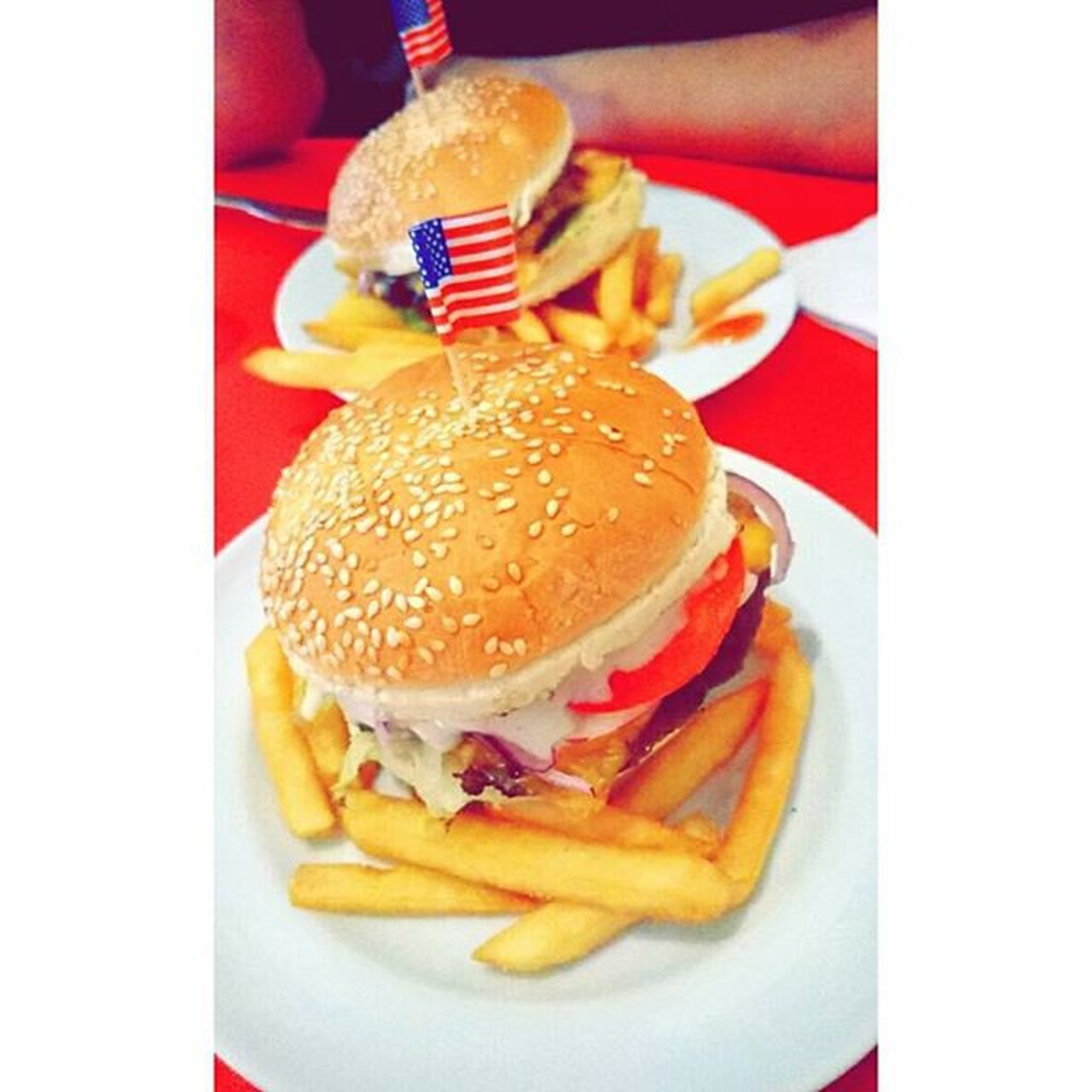 food and drink, hamburger, food, unhealthy eating, burger, ready-to-eat, indulgence, bun, table, indoors, close-up, fast food, freshness, flag, plate, slice, collage, no people, day