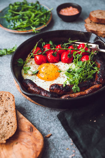Breakfast Time Table Fried Egg Pan English Sausages Cherry Tomatoes Black Microgreens Bread Eating Food Morning Bacon Toast Omelet Dish Background Vegetable Meal Fry Tasty Cooking American Roasted Yolk Traditional Homemade